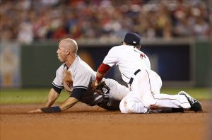 Jul 21, 2013; Boston, MA, USA; New York Yankees center fielder Brett Gardner (11) steals second base as Boston Red Sox shortstop Stephen Drew (7) applies a tag during the fourth inning at Fenway Park. Mandatory Credit: Mark L. Baer-USA TODAY Sports