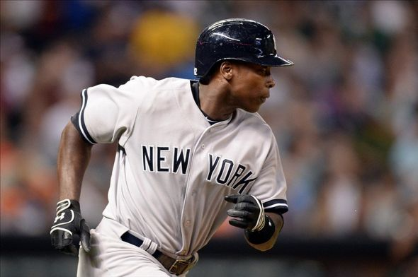 Sep 27, 2013; Houston, TX, USA; New York Yankees left fielder Alfonso Soriano (12) runs the bases before his hit was ruled a ground rule double against the Houston Astrosduring the sixth inning at Minute Maid Park. Mandatory Credit: Thomas Campbell-USA TODAY Sports