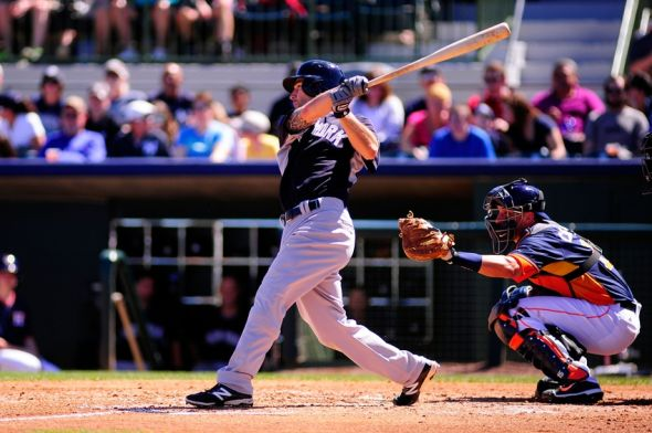 Mar 8, 2014; Kissimmee, FL, USA; New York Yankees second baseman Scott Sizemore (24) bats in the second inning against the Houston Astros in a spring training exhibition game at Osceola County Stadium. (Photo Credit: David Manning-USA TODAY Sports)
