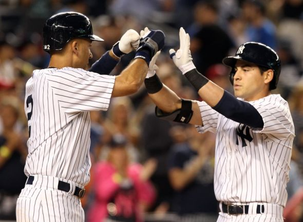 Jul 18, 2014; Bronx, NY, USA; New York Yankees center fielder Jacoby Ellsbury (22) is congratulated by shortstop Derek Jeter (2) after hitting a two-run home run against the Cincinnati Reds during the fifth inning at Yankee Stadium. Mandatory Credit: Adam Hunger-USA TODAY Sports