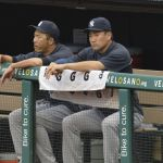 Jul 7, 2014; Cleveland, OH, USA; New York Yankees starting pitcher Hiroki Kuroda (left) and starting pitcher Masahiro Tanaka (19) sit in the dugout in the first inning against the Cleveland Indians at Progressive Field. Mandatory Credit: David Richard-USA TODAY Sports