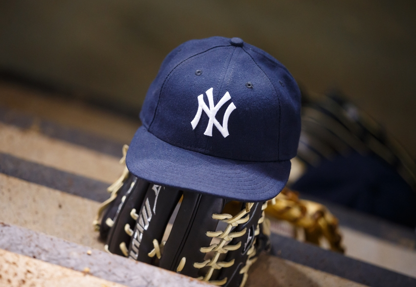 May 18, 2016; Phoenix, AZ, USA; Detailed view of a New York Yankees hat and baseball glove against the Arizona Diamondbacks at Chase Field. Mandatory Credit: Mark J. Rebilas-USA TODAY Sports