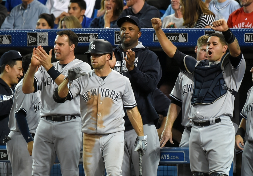Sep 26, 2016; Toronto, Ontario, CAN; New York Yankees first baseman Mark Teixeira (25), left fielder Brett Gardner(11), pitcher CC Sabathia (52) and catcher Gary Sanchez (24) react to a two-run home run hit by right fielder Aaron Hicks (not pictured) against Toronto Blue Jays in the ninth inning at Rogers Centre. Mandatory Credit: Dan Hamilton-USA TODAY Sports