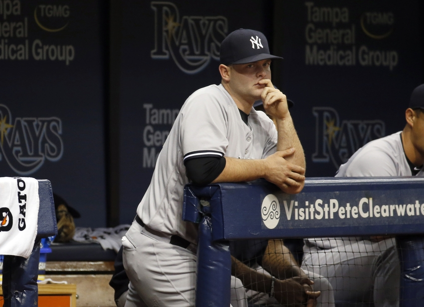 Jul 30, 2016; St. Petersburg, FL, USA; New York Yankees catcher Brian McCann (34) looks on from the dugout during the eighth inning against the Tampa Bay Rays at Tropicana Field. Tampa Bay Rays defeated the New York Yankees 6-3. Mandatory Credit: Kim Klement-USA TODAY Sports