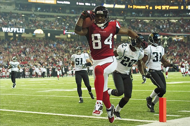 December 15, 2011; Atlanta, GA, USA; Atlanta Falcons wide receiver Roddy White (84) scores a touchdown past Jacksonville Jaguars defensive back Kevin Rutland (22) during the third quarter at the Georgia Dome. The Falcons defeated the Jaguars 41-14. Mandatory Credit: Dale Zanine-US PRESSWIRE