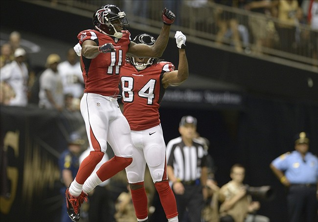 Sep 8, 2013; New Orleans, LA, USA; Atlanta Falcons wide receiver Julio Jones (11) celebrates his touchdown in the end zone with teammate wide receiver Roddy White (84) against the New Orleans Saints during the third quarter at the Mercedes-Benz Superdome. Mandatory Credit: John David Mercer-USA TODAY Sports