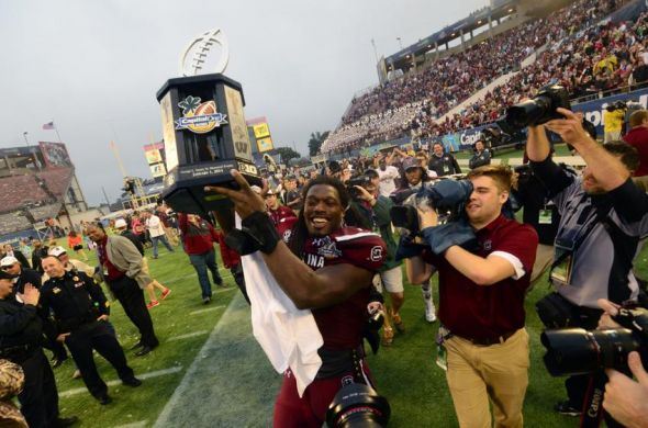 Jan 1, 2014; Orlando, FL, USA; South Carolina Gamecocks defensive end Jadeveon Clowney (7) holds up the championship trophy as the South Carolina Gamecocks beat the Wisconsin Badgers 34-24 in the Capital One Bowl at Florida Citrus Bowl. Mandatory Credit: David Manning-USA TODAY Sports