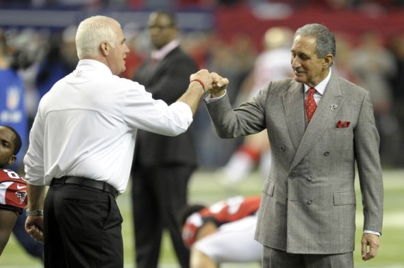 Jan 20, 2013; Atlanta, GA, USA; Atlanta Falcons head coach Mike Smith greets owner Arthur Blank prior to the NFC Championship game against the San Francisco 49ers at the Georgia Dome. Dale Zanine-USA TODAY Sports
