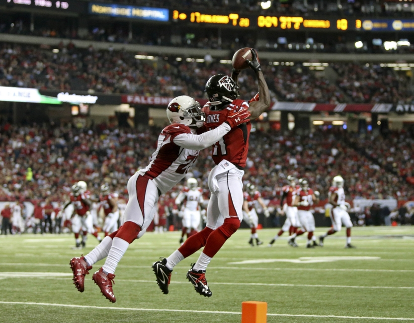 Nov 30, 2014; Atlanta, GA, USA; Atlanta Falcons wide receiver Julio Jones (11) makes a catch against Arizona Cardinals cornerback Patrick Peterson (21) in the second quarter of their game at the Georgia Dome. Mandatory Credit: Jason Getz-USA TODAY Sports