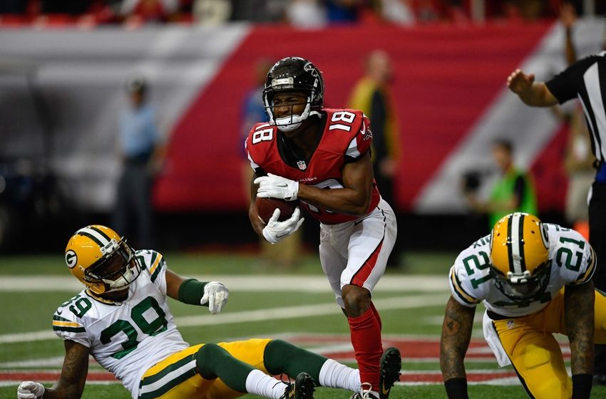Oct 30, 2016; Atlanta, GA, USA; Atlanta Falcons wide receiver Taylor Gabriel (18) reacts after catching a touchdown pass against Green Bay Packers cornerback Demetri Goodson (39) during the first quarter at the Georgia Dome. Mandatory Credit: Dale Zanine-USA TODAY Sports