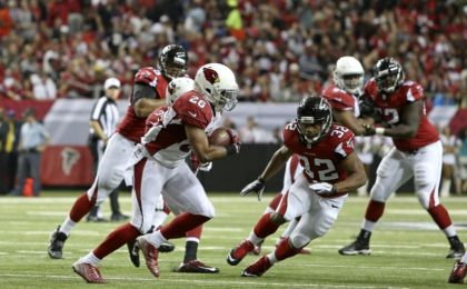 Nov 30, 2014; Atlanta, GA, USA; Arizona Cardinals free safety Rashad Johnson (26) returns an interception for a touchdown as he runs past Atlanta Falcons running back Jacquizz Rodgers (32) in the second quarter of their game at the at the Georgia Dome. Mandatory Credit: Jason Getz-USA TODAY Sports