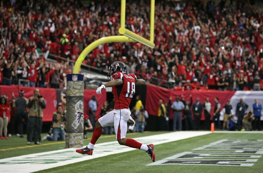 Nov 27, 2016; Atlanta, GA, USA; Atlanta Falcons wide receiver Taylor Gabriel (18) runs after a catch for a touchdown in the second quarter of their game against the Arizona Cardinals at the Georgia Dome. Mandatory Credit: Jason Getz-USA TODAY Sports