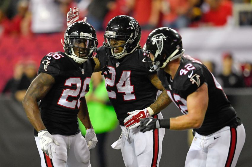 Dec 18, 2016; Atlanta, GA, USA; Atlanta Falcons running back Devonta Freeman (24) reacts with Tevin Coleman (26) and Patrick DiMarco (42) after scoring a touchdown against the San Francisco 49ers during the second half at the Georgia Dome. The Falcons defeated the 49ers 41-13. Mandatory Credit: Dale Zanine-USA TODAY Sports