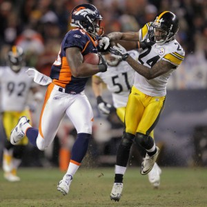 Demaryius Thomas fights off Ike Taylor to run 80 yards for the game winning touchdown. (Doug Pensinger/Getty Images)