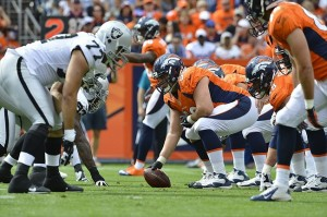 September 30 2012; Denver, CO, USA; Denver Broncos center J.D. Walton (50) prepares to snap the football during second quarter of the game against the Oakland Raiders at Sports Authority Field. Mandatory Credit: Ron Chenoy-USA TODAY Sports