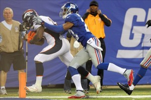 Knowshon Moreno (27) scores a touchdown in front of New York Giants corner back Corey Webster (23) during the third quarter of a game at MetLife Stadium. The Broncos defeated the Giants 41-23. (Brad Penner-USA TODAY Sports)