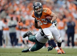 Sep 29, 2013; Denver, CO, USA; Denver Broncos wide receiver Wes Welker (83) breaks a tackle by Philadelphia Eagles linebacker Brandon Graham (55) in the third quarter at Sports Authority Field at Mile High. The Broncos defeated the Eagles 52-20. Mandatory Credit: Ron Chenoy-USA TODAY Sports