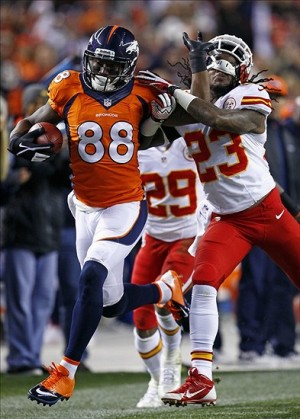 Nov 17, 2013; Denver, CO, USA; Denver Broncos wide receiver Demaryius Thomas (88) gets caught up with Kansas City Chiefs strong safety Eric Berry (29) in the second quarter at Sports Authority Field at Mile High. Mandatory Credit: Isaiah J. Downing-USA TODAY Sports