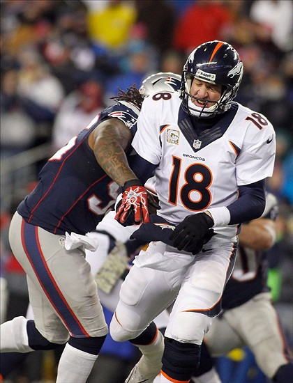 Nov 24, 2013; Foxborough, MA, USA; New England Patriots middle linebacker Brandon Spikes (55) pressures Denver Broncos quarterback Peyton Manning (18) during the fourth quarter at Gillette Stadium. The Patriots defeated the Broncos 34-31 in overtime. Mandatory Credit: Stew Milne-USA TODAY Sports