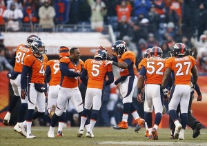 Matt Prater (5) celebrates with teammates after kicking a 64 yard field goal at the end of the first half against the Tennessee Titans at Sports Authority Field at Mile High. (Chris Humphreys-USA TODAY Sports)