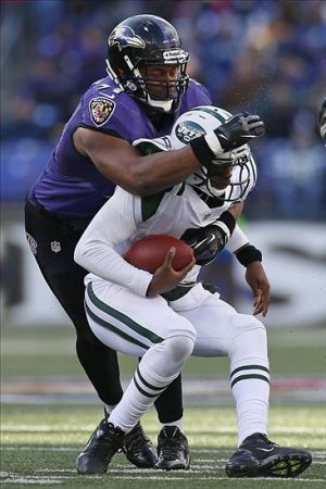 Nov 24, 2013; Baltimore, MD, USA; Baltimore Ravens linebacker Daryl Smith (51) sacks New York Jets quarterback Geno Smith (7) in the first half at M&T Bank Stadium. Mandatory Credit: Mitch Stringer-USA TODAY Sports