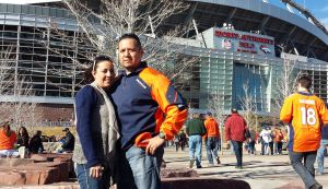 Randy Ybarra and his wife before the 2013 AFC Championship against the New England Patriots