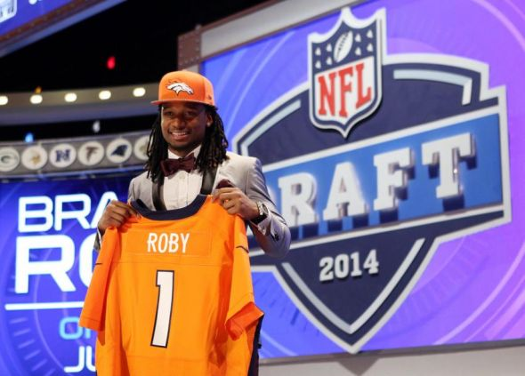 May 8, 2014; New York, NY, USA; Bradley Roby (Ohio State) holds up his jersey after being selected as the number thirty-one overall pick in the first round of the 2014 NFL Draft to the Denver Broncos at Radio City Music Hall. Mandatory Credit: Adam Hunger-USA TODAY Sports