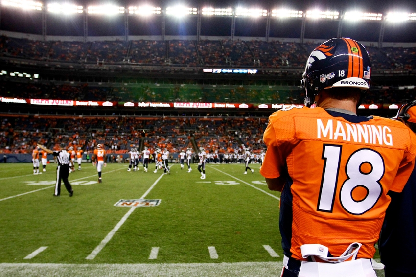 Aug 23, 2014; Denver, CO, USA; Denver Broncos quarterback Peyton Manning (18) watches from the sidelines in the fourth quarter against the Houston Texans at Sports Authority Field at Mile High. The Texans defeated the Broncos 18-17. Mandatory Credit: Isaiah J. Downing-USA TODAY Sports