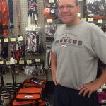 "Predominantly Orange contributing writer, Craig Hurst, in front of Bronco stuff at a Colrado Wal-Mart. ""We're not in Kansas anymore Toto"""