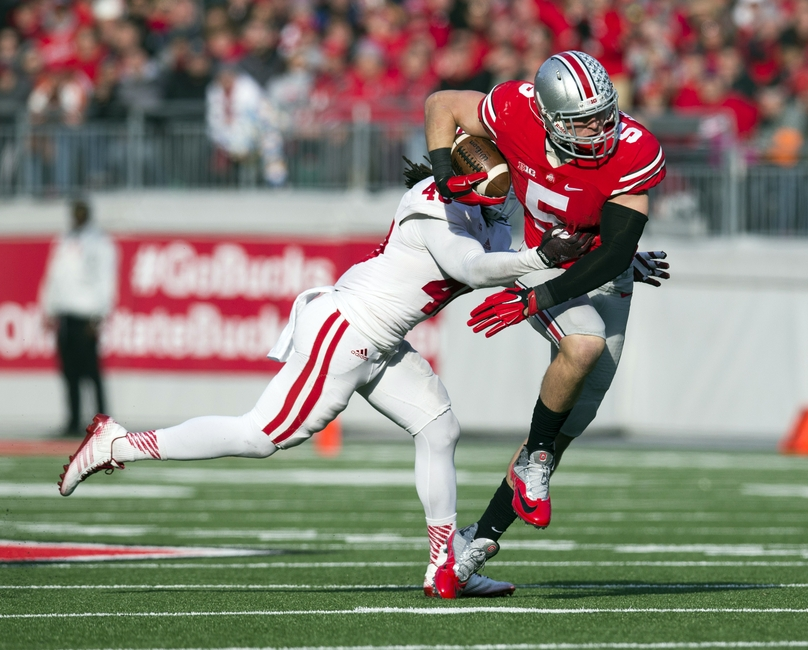 Nov 22, 2014; Columbus, OH, USA; Ohio State Buckeyes tight end Jeff Heuerman (5) is tackled by Indiana Hoosiers safety Antonio Allen (40) at Ohio Stadium. Ohio State won the game 42-27. Mandatory Credit: Greg Bartram-USA TODAY Sports