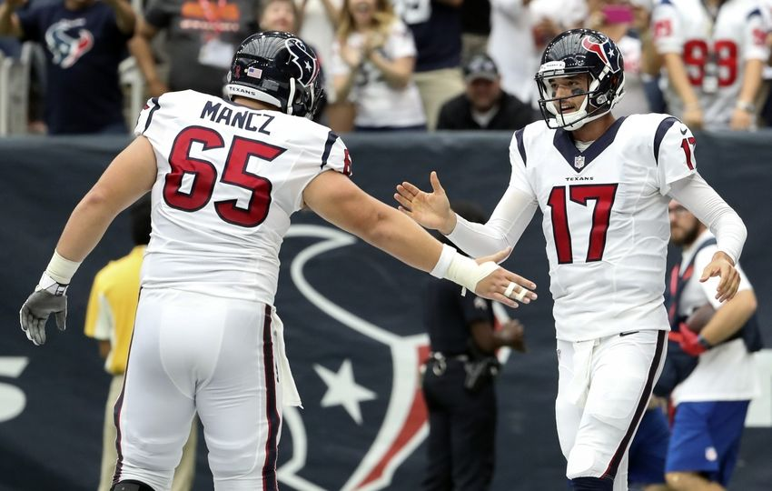 Sep 11, 2016; Houston, TX, USA;  Houston Texans quarterback Brock Osweiler (17) celebrates with  center Greg Mancz (65) after throwing a touchdown pass against the Chicago Bears during the first half at NRG Stadium. Mandatory Credit: Kevin Jairaj-USA TODAY Sports