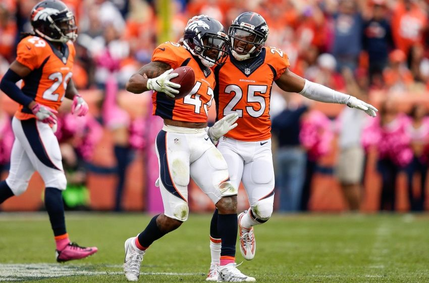 Oct 9, 2016; Denver, CO, USA; Denver Broncos strong safety T.J. Ward (43) celebrates his fumble recovery with cornerback Chris Harris Jr. (25) in the third quarter against the Atlanta Falcons at Sports Authority Field at Mile High. The Falcons won 23-16. Mandatory Credit: Isaiah J. Downing-USA TODAY Sports