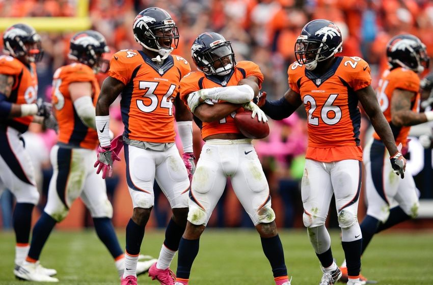 Oct 9, 2016; Denver, CO, USA; Denver Broncos strong safety T.J. Ward (43) celebrates his fumble recovery with free safety Darian Stewart (26) and defensive back Will Parks (34) in the third quarter against the Atlanta Falcons at Sports Authority Field at Mile High. The Falcons won 23-16. Mandatory Credit: Isaiah J. Downing-USA TODAY Sports