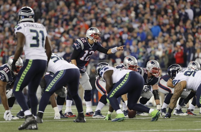 Nov 13, 2016; Foxborough, MA, USA; New England Patriots quarterback Tom Brady (12) at the line of scrimmage against the Seattle Seahawks in the first quarter at Gillette Stadium. Mandatory Credit: David Butler II-USA TODAY Sports