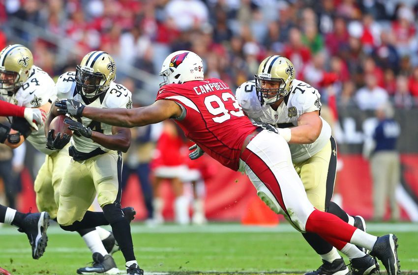 Dec 18, 2016; Glendale, AZ, USA; New Orleans Saints offensive tackle Andrus Peat (75) blocks for running back Tim Hightower (34) against Arizona Cardinals defensive tackle Calais Campbell (93) at University of Phoenix Stadium. The Saints defeated the Cardinals 48-41. Mandatory Credit: Mark J. Rebilas-USA TODAY Sports