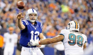 Nov 4, 2012; Indianapolis, IN, USA; Indianapolis Colts quarterback Andrew Luck (12) throws a pass over Miami Dolphins defensive end Jared Odrick (98) during the game at Lucas Oil Stadium. Mandatory Credit: Thomas J. Russo-USA TODAY Sports