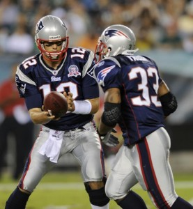 Brady & Faulk - AP Photo by Michael Perez