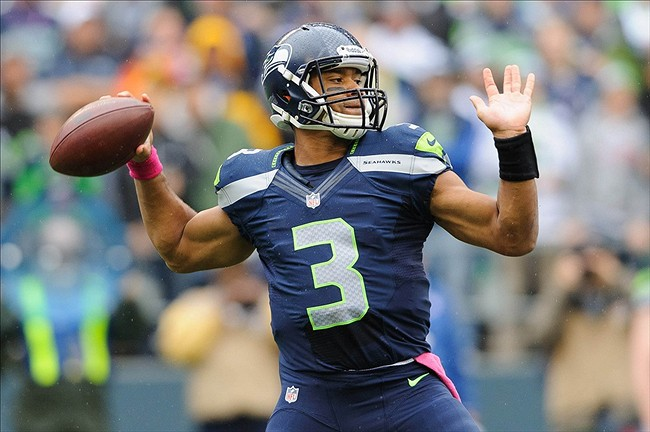 Oct 14, 2012; Seattle, WA, USA; Seattle Seahawks quarterback Russell Wilson (3) passes the ball during the 1st half against the New England Patriots at CenturyLink Field. Mandatory Credit: Steven Bisig-US PRESSWIRE