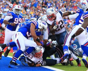 Sep 30, 2012; Orchard Park, NY, USA; New England Patriots running back Stevan Ridley (22) scores a touchdown against the Buffalo Bills during the second half at Ralph Wilson Stadium. Patriots beat the Bills 52-28. Mandatory Credit: Kevin Hoffman-US PRESSWIRE