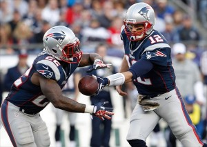 Nov 11, 2012; Foxborough, MA, USA; New England Patriots quarterback Tom Brady (12) hands off the ball to running back Stevan Ridley (22) as they take on the Buffalo Bills during the second half at Gillette Stadium. The Patriots defeated the Bills 37-31. Mandatory Credit: David Butler II-USA TODAY Sports