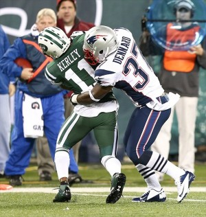 Nov. 22, 2012; East Rutherford, NJ, USA; New York Jets wide receiver Jeremy Kerley (11) is tackled by New England Patriots cornerback Alfonzo Dennard (37) during the second half on Thanksgiving at Metlife Stadium. Patriots won 49-19. Mandatory Credit: Debby Wong-USA TODAY Sports