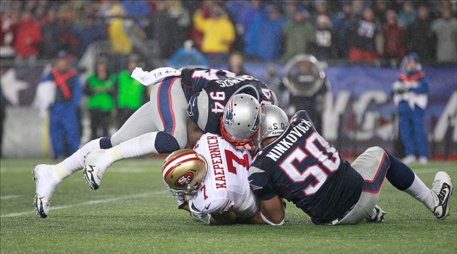 Dec 16, 2012; Foxboro, Massachusetts, USA; San Francisco 49ers quarterback Colin Kaepernick (7) gets sacked by New England Patriots defensive end Rob Ninkovich (50) and defensive end Justin Francis (94) during the fourth quarter at Gillette Stadium. The San Francisco 49ers won 41-34. Mandatory Credit: Greg M. Cooper-USA TODAY Sports