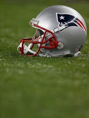A New England Patriots helmet rests on the side line during the third quarter against the Baltimore Ravens at Gillette Stadium. Mandatory Credit: Greg M. Cooper-USA TODAY Sports