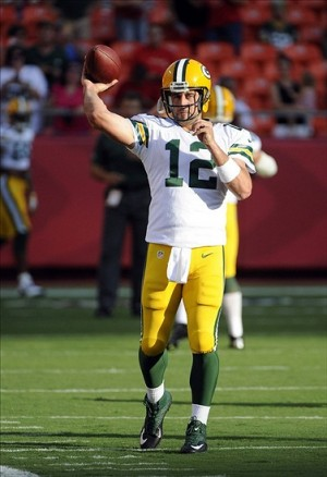 Aug 29, 2013; Kansas City, MO, USA; Green Bay Packers quarterback Aaron Rodgers (12) warms up before the game against the Kansas City Chiefs at Arrowhead Stadium. Mandatory Credit: John Rieger-USA TODAY Sports