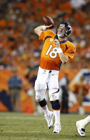 Sep 5, 2013; Denver, CO, USA; Denver Broncos quarterback Peyton Manning (18) passes the ball during the second half against the Baltimore Ravens at Sports Authority Field at Mile High. Mandatory Credit: Chris Humphreys-USA TODAY Sports