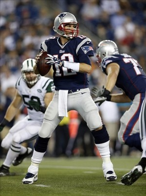 Sep 12, 2013; Foxborough, MA, USA; New England Patriots quarterback Tom Brady (12) prepares to make a pass during the first quarter against the New York Jets at Gillette Stadium. Mandatory Credit: Greg M. Cooper-USA TODAY Sports