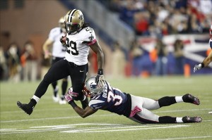 Oct 13, 2013; Foxborough, MA, USA; New England Patriots cornerback Alfonzo Dennard (37) tackles New Orleans Saints running back Khiry Robinson (29) during the second half at Gillette Stadium. Mandatory Credit: Mark L. Baer-USA TODAY Sports