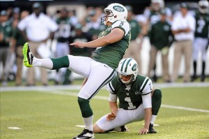 Oct 20, 2013; East Rutherford, NJ, USA; New York Jets kicker Nick Folk (2) watches his game winning field goal against the New England Patriots during overtime at MetLife Stadium. The Jets won the game 30-27 in overtime. Mandatory Credit: Joe Camporeale-USA TODAY Sports