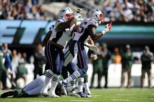 Oct 20, 2013; East Rutherford, NJ, USA; New England Patriots defensive end Chandler Jones (95) celebrates a sack of New York Jets quarterback Geno Smith (7) during the first half at MetLife Stadium. The Jets won the game 30-27 in overtime. Mandatory Credit: Joe Camporeale-USA TODAY Sports