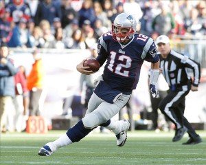 Oct 27, 2013; Foxborough, MA, USA; New England Patriots quarterback Tom Brady (12) scrambles for a first down against the Miami Dolphins during the fourth quarter at Gillette Stadium. Mandatory Credit: Stew Milne-USA TODAY Sports